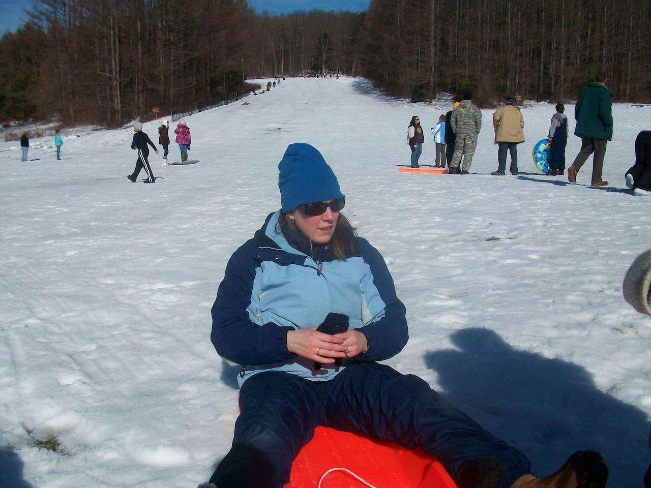 sled riding at Chapman dam