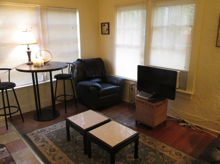 Super comfortable living room with flat screen tv and cable.
