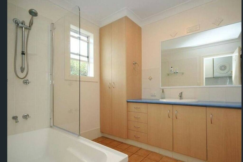 Good sized bathroom with toilet. Additional toilet located off the laundry.