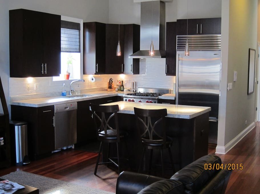 Open kitchen with subzero appliances ... great for cooking!