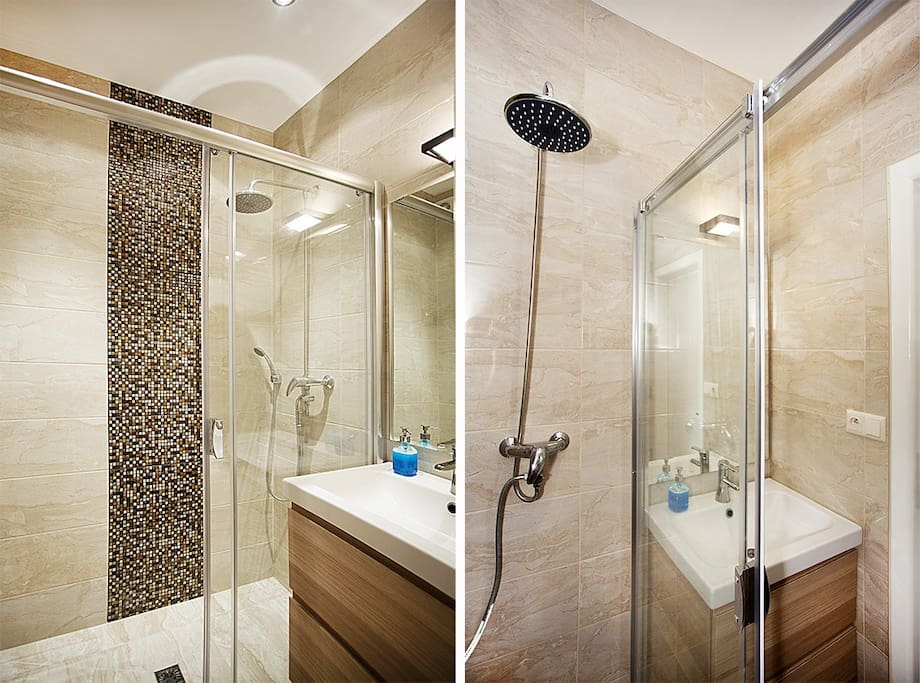 The spasious shower in the designed bathroom