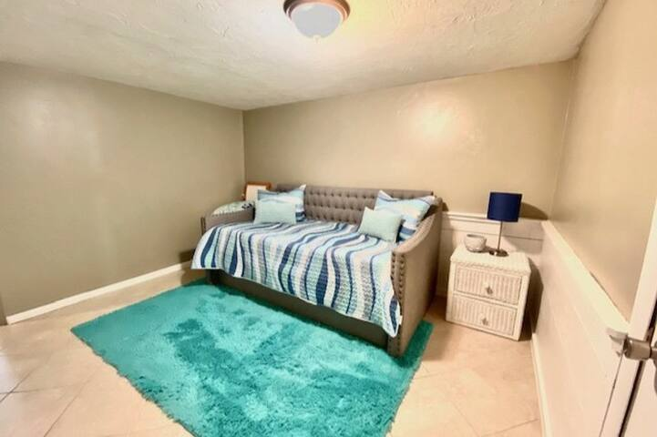 The kids will love the lower level day bed including a trundle (second twin underneath) and super soft turquoise blue shag rug.