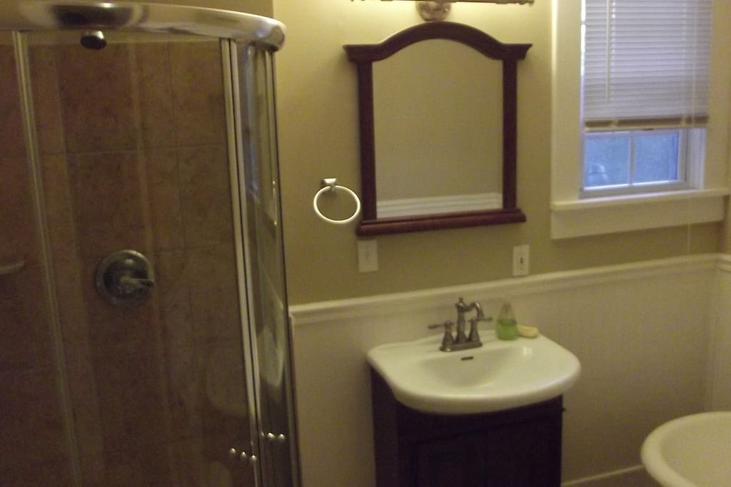 Master bath has claw foot tub, shower and vanity. All tiled