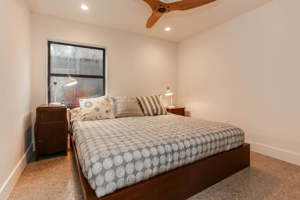 The main bedroom has an organic king size bed with Haiku fan and toxin-free ductless mini-split air conditioner.