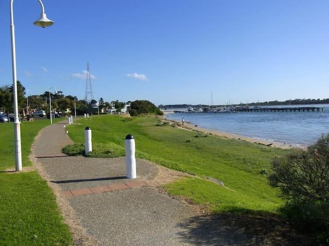Walk along waters edge to jetty