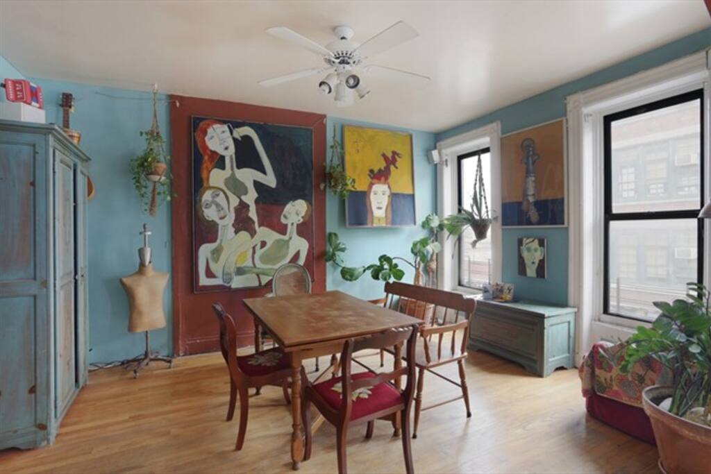 Bright dining room with original paintings