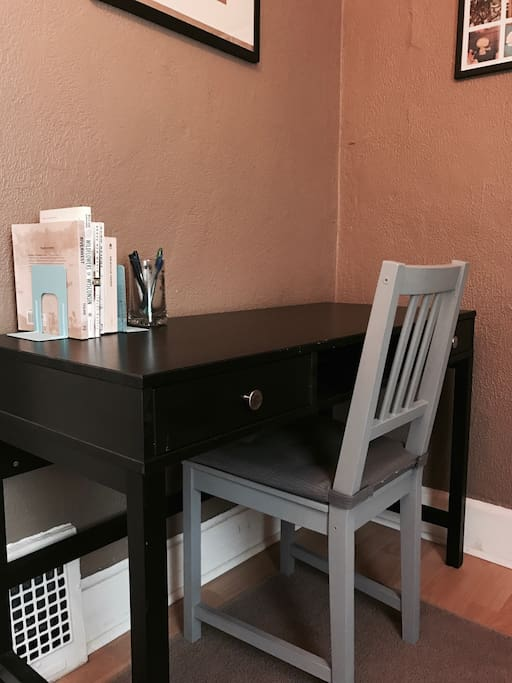 Desk area in guest room with close power outlet access.