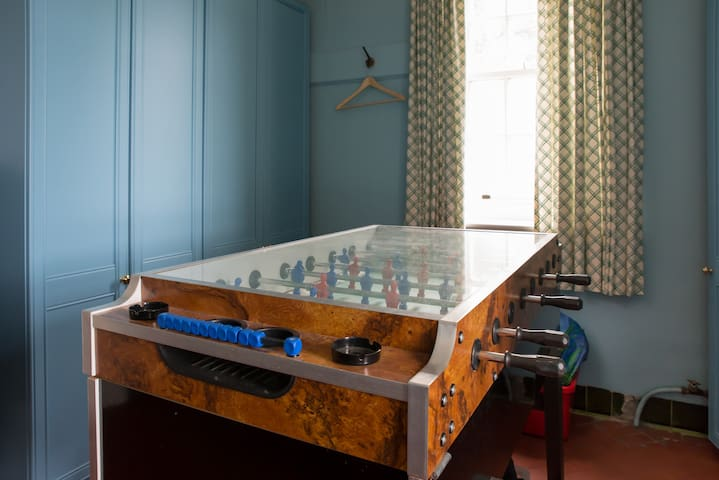 adjacent table football in cloakroom