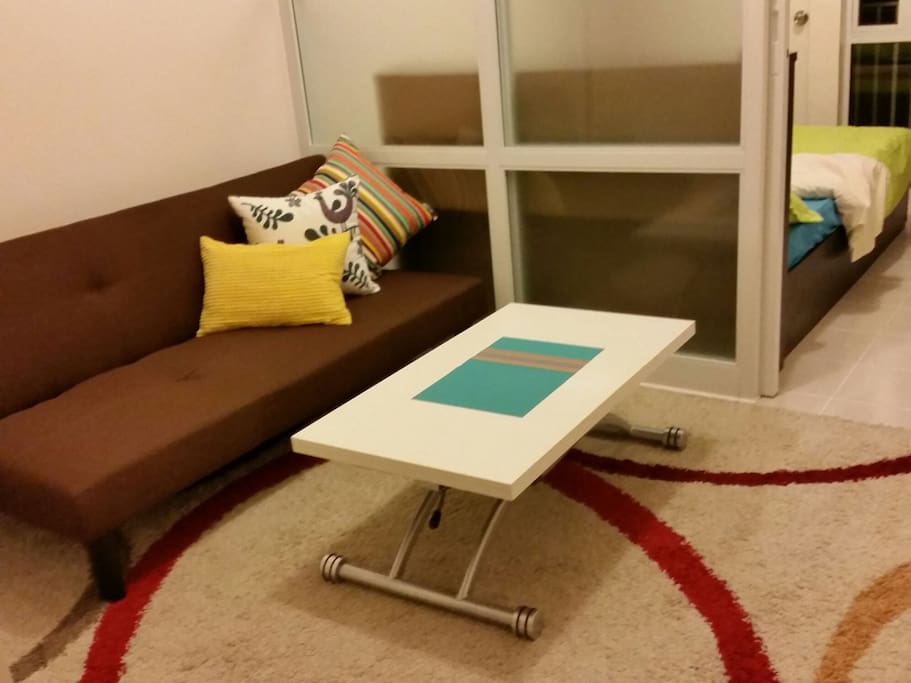 The condo is equipped w/ a sofa bed and a RoboTable that has hydraulics that conveniently transforms from a coffee table to a dining table. :)