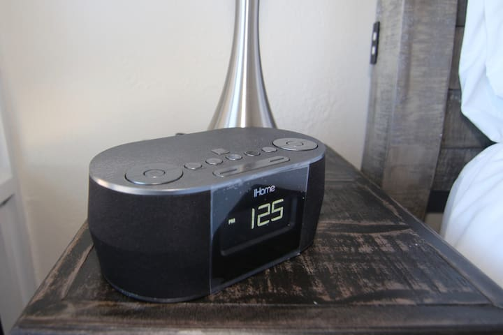 Bluetooth enabled Stereo alarm clock with USB charging cables for every smart device.