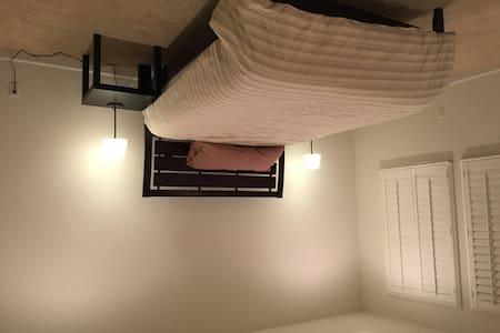Master bedroom, private bath & TV