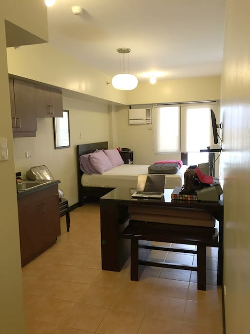 Studio unit with queen-sized bed.