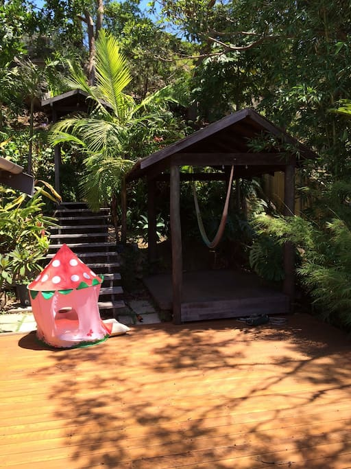 Relax in the hammock or explore the lush back garden