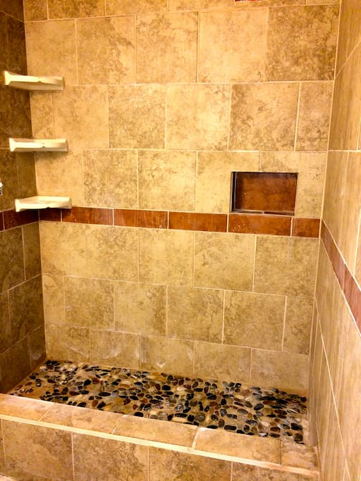 Just a bit more finishing touches to the new renovated master bathroom and we'll be ready to take more pictures. Meanwhile, this is a sneak preview of the step-in shower with river-rock floor...ahhh, almost like taking a shower under a tropical waterfall.