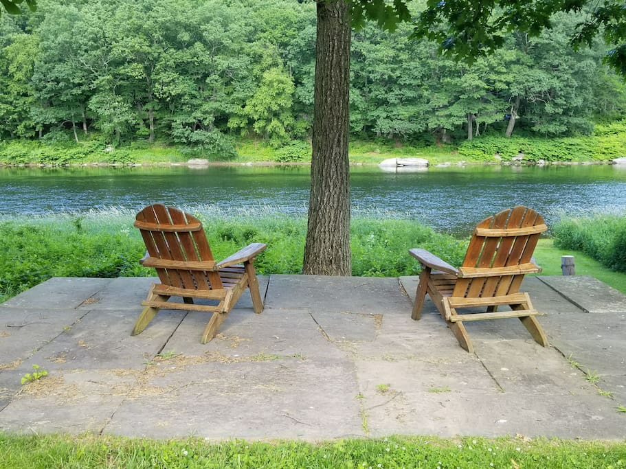 pristine riverfront relaxation on Adirondack chairs, under hickory tree shade