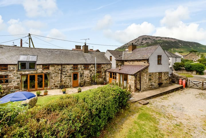 Traditional stone house with patio and gardens and parking