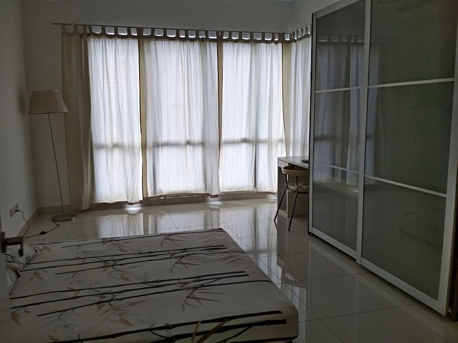 Master Bedroom with bathroom attached. Comes with wardrobe, table, kingsize bed, aircond/fan and water heater.
