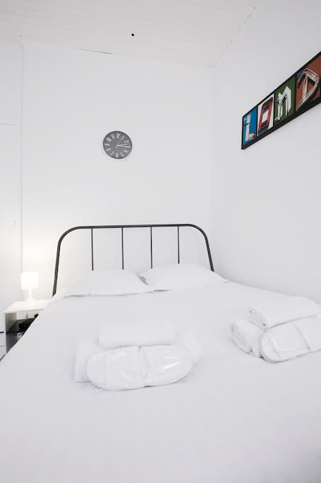 Comfortable double bed with pristine bed linen.
