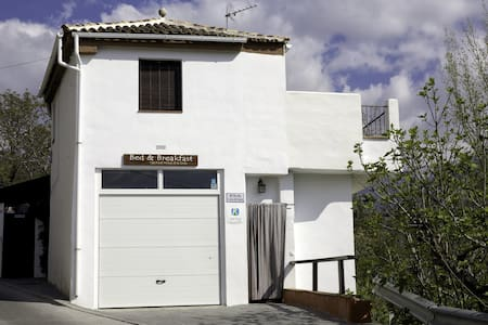 Casa rural Arroyo de la Greda is an authentic, friendly and homely Bed and Breakfast with 3 ample and luxurious rooms, located on the border of a typical picturesque Andalucian mountain village Güéjar Sierra, next to Sierra Nevada.