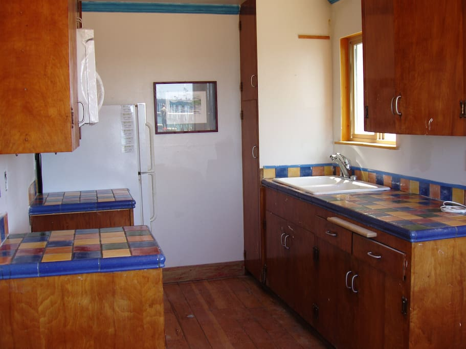 Kitchen with new appliances and bright tile