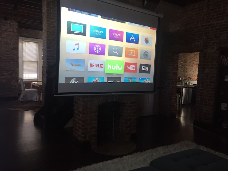 Pull down projection screen with Apple TV, Hulu and Netflix