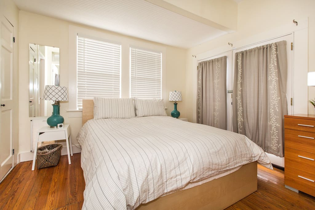 Bedroom Two - Features a brand new queen-sized, memory foam mattress with access to private, fenced yard & web-enabled TV equipped with cable.