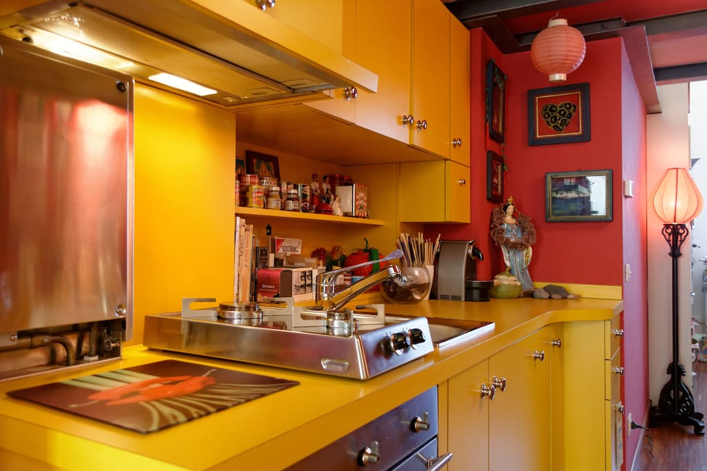 The colorful kitchen with double cooking space, oven, coffee-machine, fridge/freezer. Sorry no microwave