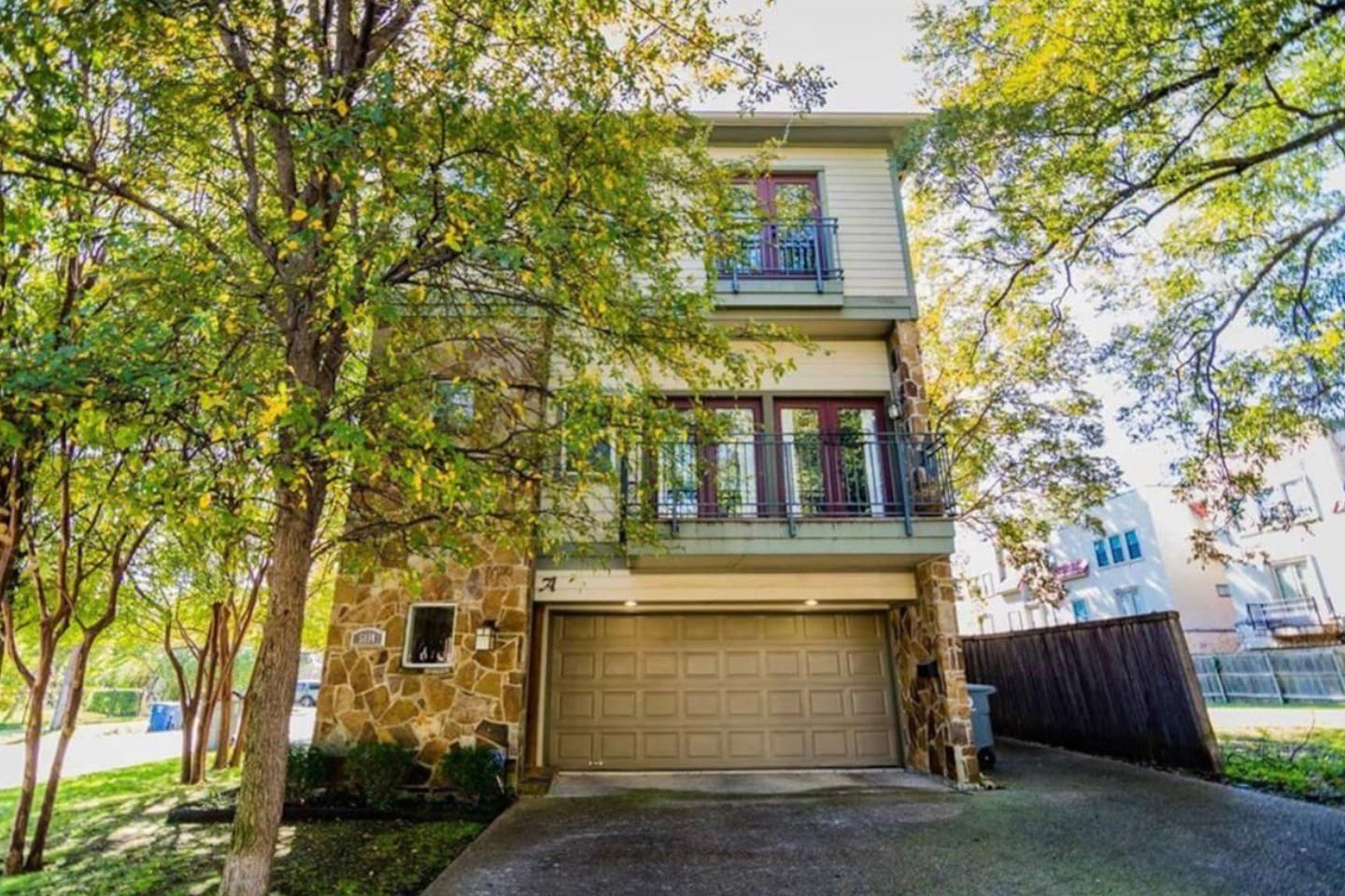 Outdoor view of our 3 story condo nestled on a quiet street with a lovely view. Close to all the action Dallas has to offer!