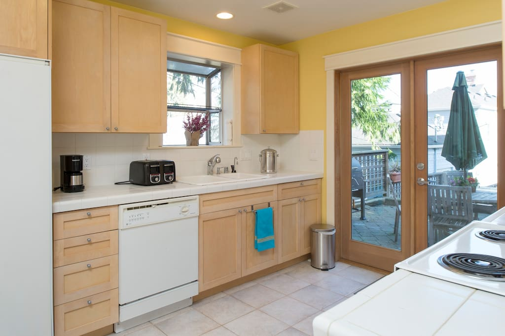 Fully equipped kitchen with outdoor patio.