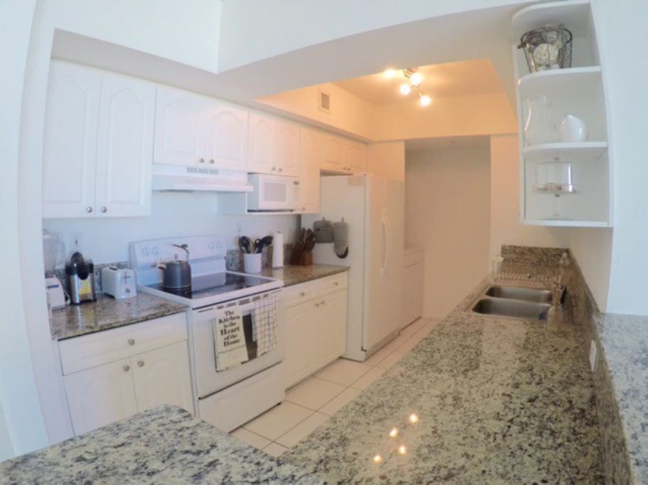 Beautiful kitchen with all the utensils and require equipment for a nice cooking experience