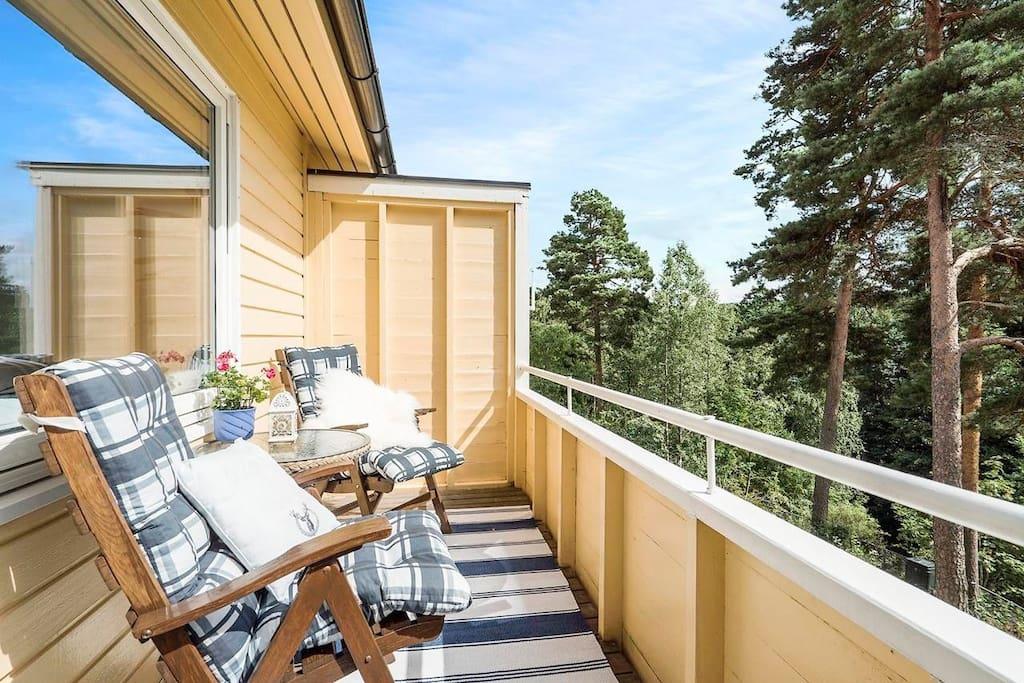 Sunny balcony with sunchairs.