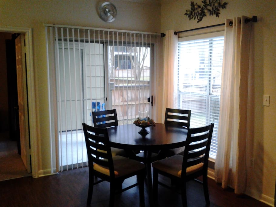 Dining room includes table with access to patio and yard