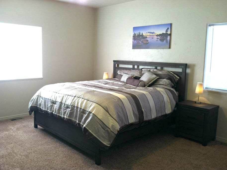 Large master suite with king bed, sitting area, private bath and walk-in closet.