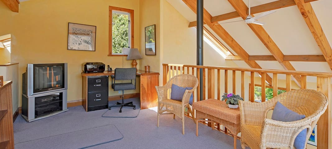 Study, mezzanine (upstairs, overlooking living area)