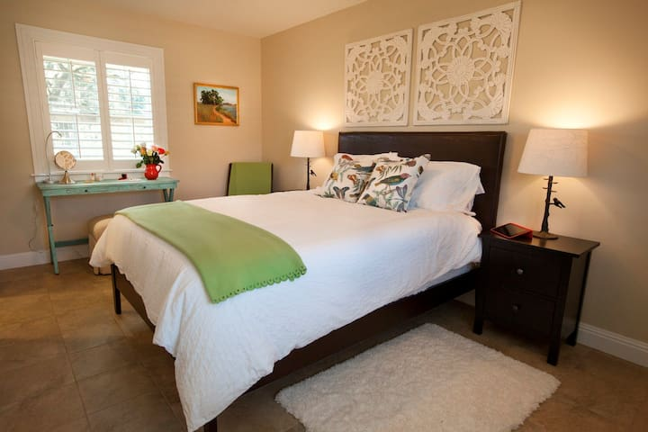 The Guest Cottage bedroom has a pillow-top Queen bed, 400-thread count cotton sheets, plush blanket, seasonal weight duvets and your choice of memory foam and down-alternative pillows.