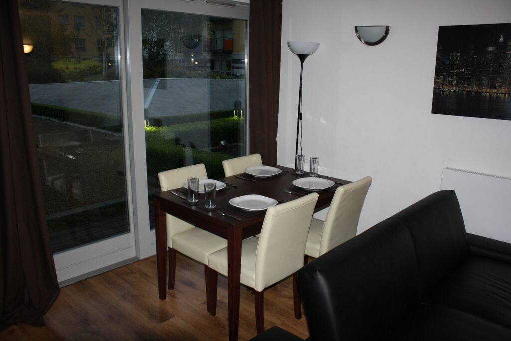 4 seater dining table with a back exit on to a communal private courtyard
