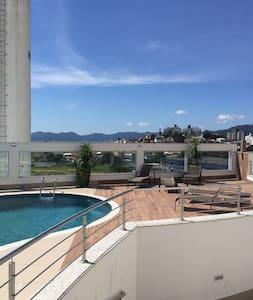 Quarto em Apartamento novo completo - Florianópolis - Lejlighed