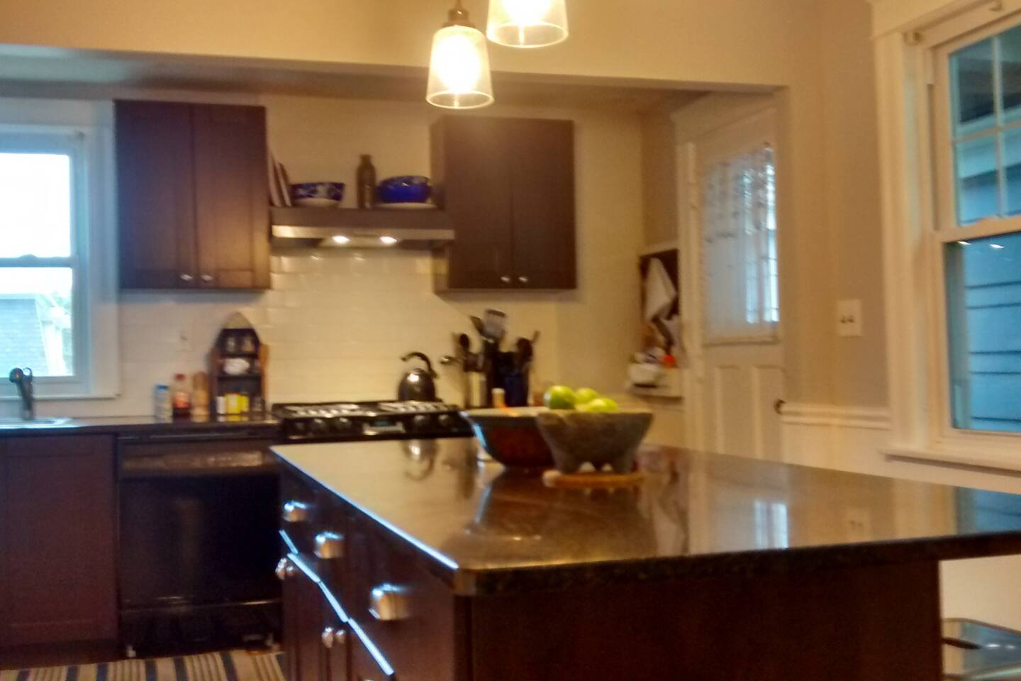 Newly Remodeled  traditional cape cod.  Modern kitchen, open concept, granite countertops, refinished floors