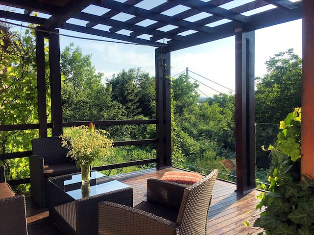 PERGOLA HOUSE IN A GREEN OASIS WITH FANTASTIC VIEW