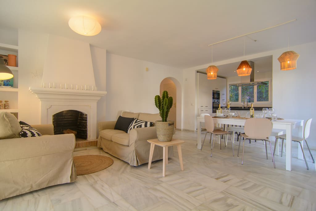 Living room with marble tiles, fireplace and table