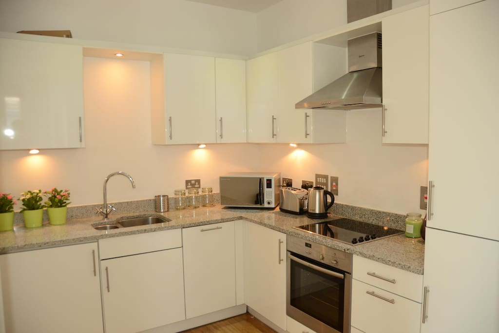 Modern Kitchen, with washer dryer, dishwasher, microwave etc.