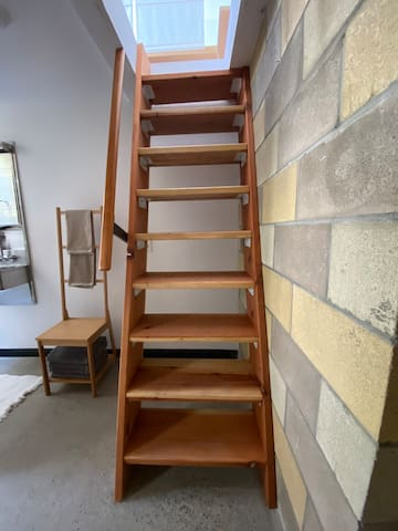 You will need to walk up the staircase/ladder to access the loft bed.