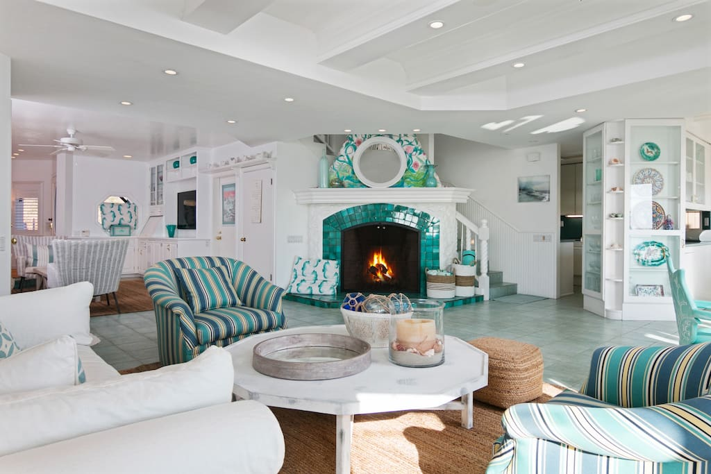 Decorative turquoise tiles surround the fireplace, which offers warmth and ambiance on cool nights.