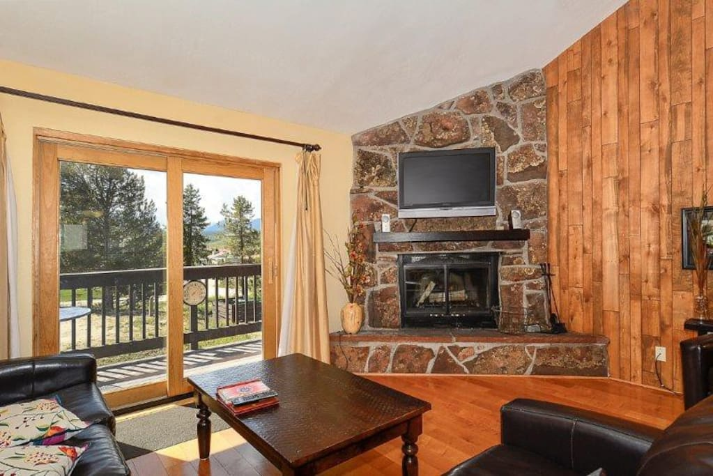 Cozy up by the fireplace and watch a movie on the flat screen TV