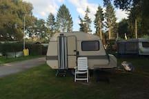 Caravan on campsite at lake.