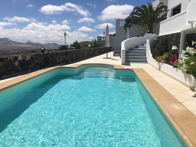 Private heated swimming pool and terrace with stunning panoramic views across the south of the island.