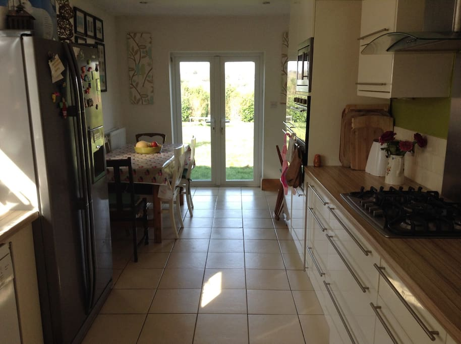 Spacious kitchen diner seats 6/8. Integrated double oven, gas hob with wok burner and built in microwave with grill. Full size dishwasher and large american style fridge freezer perfect for a large family or group. French doors leads out onto the larger than average garden.