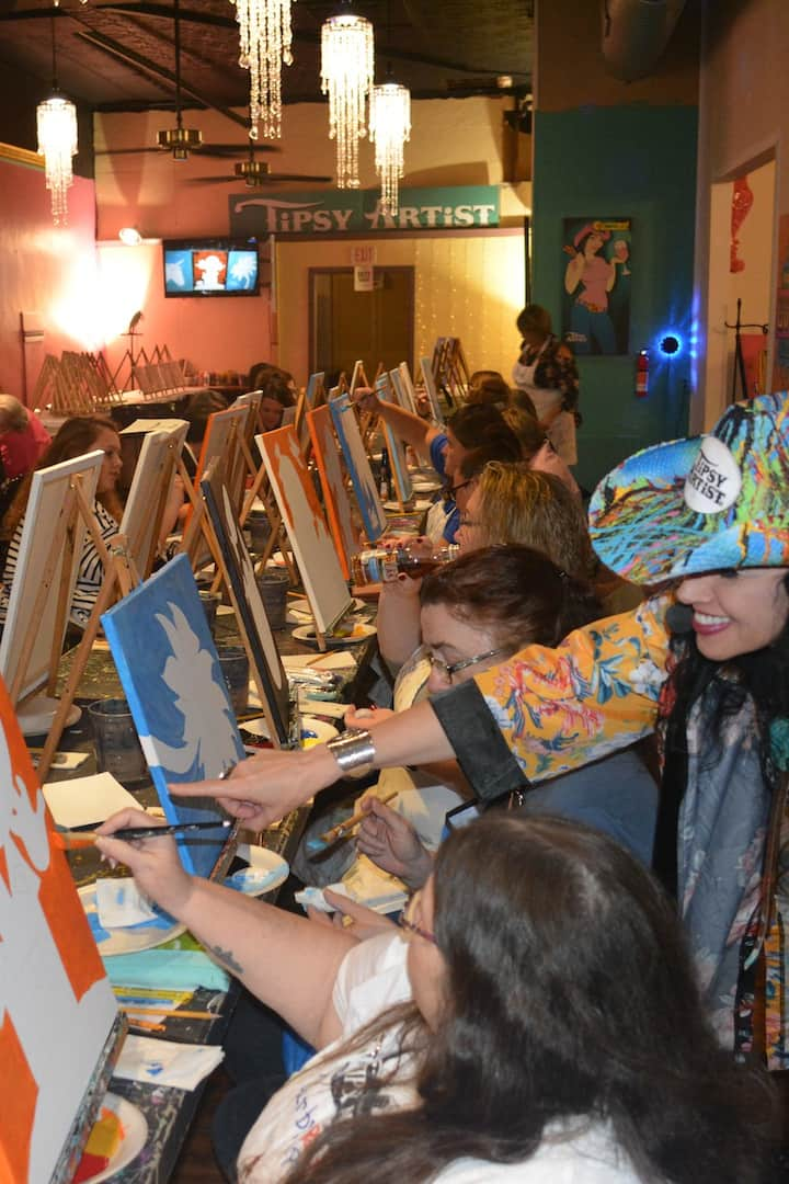 Painting in process during the show