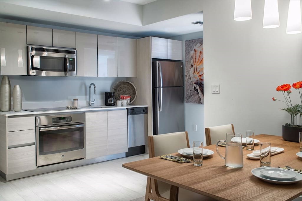 Prepare delicious meals in the beautiful kitchen complete with stainless steel appliances.