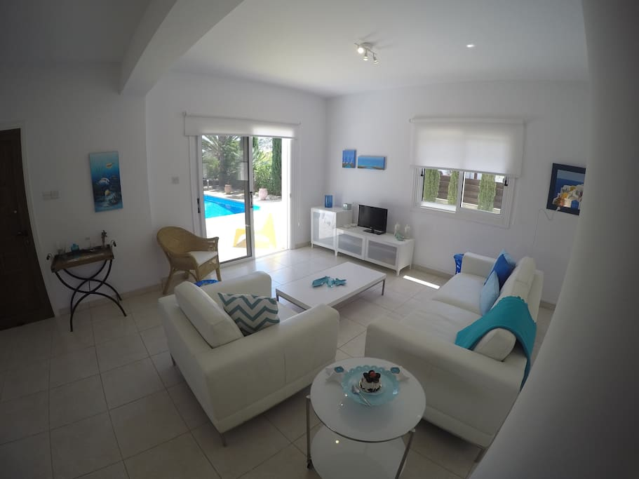 Living room area leading out to the pool